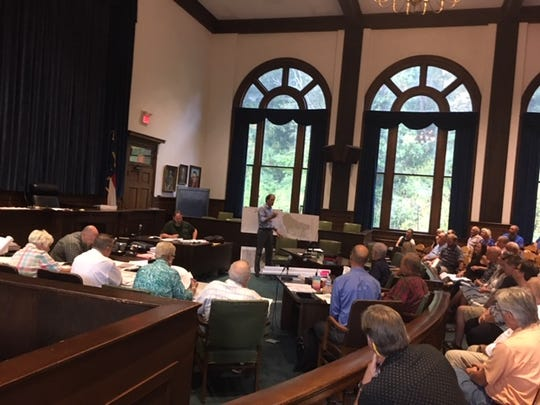 Joel Osgood, landscape architect, shows a map of the project to the audience attending a Madison County Planning Board meeting Sept. 17, 2019. The meeting focused on plans for a proposed School of Wholeness and Enlightenment retreat center.