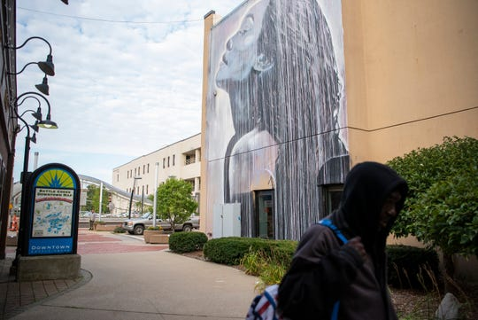 A mural outside Cereal City Tattoo by the artist Starfighter is pictured on Thursday, Sept. 19, 2019 in Battle Creek, Mich.