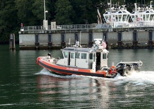 A vessel with the US Coast Guard Marine Forces Protection Unit heads back to the dock at Naval Base Kitsap Bangor on Wednesday, September 18, 2019.