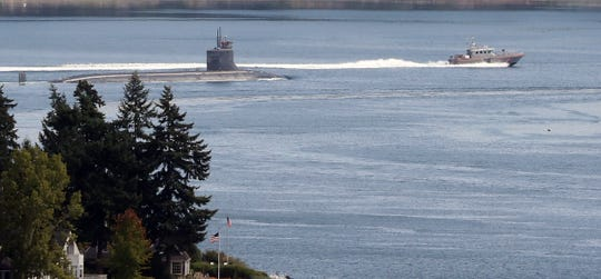 A Coast Guard patrol boat from the Marine Forces Protection Unit at Bangor escorts the USS Connecticut through Rich Passage on Sept. 5. The MFPU is a partnership between the Navy and the Coast Guard.