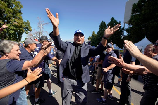 BYU head coach Kalani Sitake greets fans as he arrives before an NCAA college football game against Southern California, Saturday, Sept. 14, 2019, in Provo, Utah.