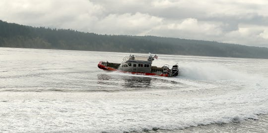 A vessel with the US Coast Guard Marine Forces Protection Unit at Naval Base Kitsap Bangor makes a tight turn in Hood Canal on Wednesday, September 18, 2019.