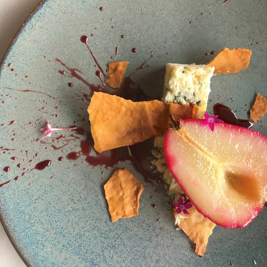 The Fat Snook in Cocoa Beach, known for artful, innovative dishes such as this Petite Syrah Poached Pear dessert, received a Golden Spoon for the second year in a row.