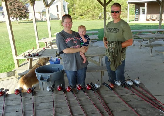 Ruth Malpas, holding her son Benjamin, and her brother Samuel Ballou stand in a pavilion at Elkhorn Lake Hunt Club, which they operate along with their parents. The club's annual family field day will be Sept. 28.