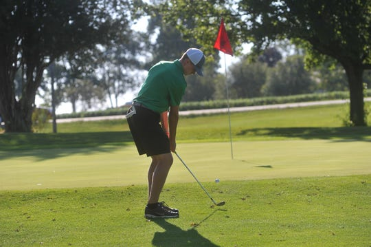 Clear Fork's Caleb Dettmer chips onto the 18th green at Valley View.