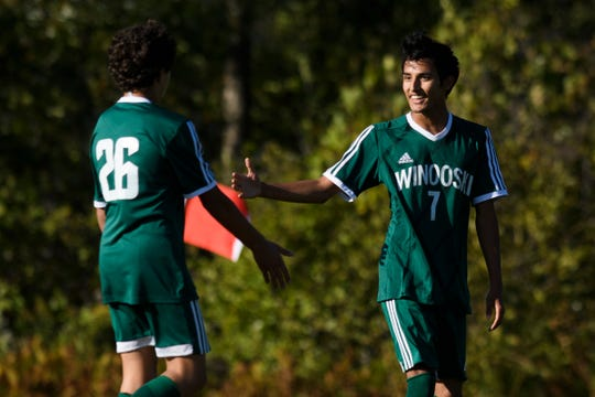 Winooski's Lek Nath Luitel (7) and Ayoob Musanovic (26) celebrates a goal during the boys soccer game between Oxbow vs. Winooski at Winooski High School on Wednesday afternoon September 18, 2019 in Winooski, Vermont.