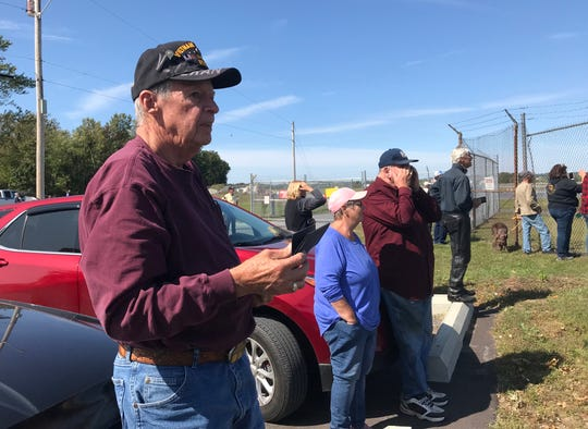Dennis Conly of Cambridge, a Vietnam War Army veteran, is among the spectators gathered to watch the landing of Vermont Air National Guard's first F-35 planes at Burlington International Airport on Sept. 19, 2019.