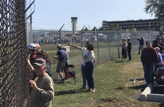 Spectators gather to watch the landing of Vermont Air National Guard's first F-35 planes at Burlington International Airport on Sept. 19, 2019.