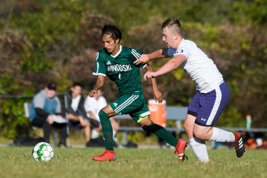 Winooski's Lek Nath Luitel (7) runs past Oxbow's Zach Kane (11) with the ball during the boys soccer game between Oxbow vs. Winooski at Winooski High School on Wednesday afternoon September 18, 2019 in Winooski, Vermont.