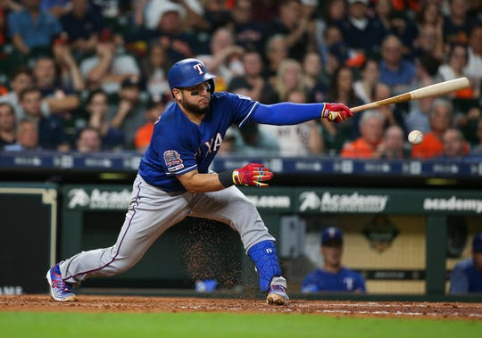 Sep 18, 2019; Houston, TX, USA; Texas Rangers catcher Jose Trevino (56) hits a single during the eighth inning against the Houston Astros at Minute Maid Park. Mandatory Credit: Troy Taormina-USA TODAY Sports