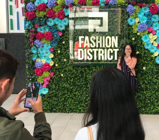 Hong Hanh Vo of Philadelphia poses for a photo at the grand opening Thursday of Fashion District Philadelphia.