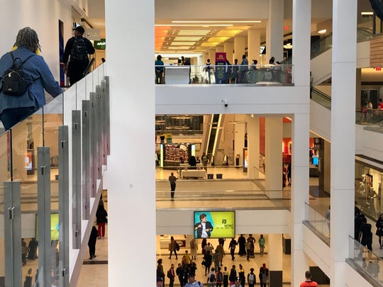 Shoppers stream through the three levels of Fashion District Philadelphia at the retail center's grand opening Thursday.