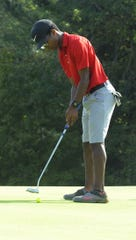 Piketon's Denzel Endicott putts a ball in the Scioto Valley Conference No. 7 and No. 8 golf matches on Thursday September 19.
