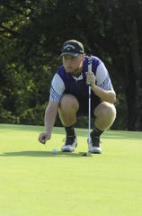 Unioto golf's Ty Schobelock marks his ball on the green at the Scioto Valley Conference No. 7 and No. 8 golf matches on Thursday September 19.