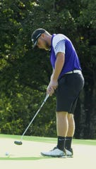 Unioto golf's Ty Schobelock putts a ball during the Scioto Valley Conference No. 7 and No. 8 golf matches on Thursday September 19.