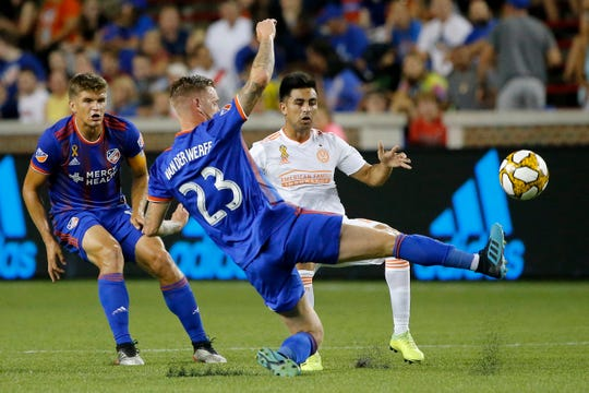 FC Cincinnati defender Maikel van der Werf (23) kicks the ball away in the first half of the MLS match between FC Cincinnati and Atlanta United at Nippert Stadium in Cincinnati on Wednesday, Sept. 18, 2019. The match was tied 0-0 at halftime.