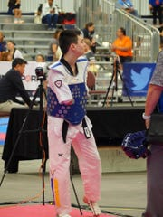 Austin Osner was born with one arm. He is preparing for the 2024 Paralympics in TaeKwonDo