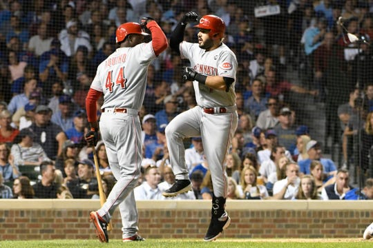 Sep 18, 2019; Chicago, IL, USA; Cincinnati Reds third baseman Eugenio Suarez (7) is greeted by right fielder Aristides Aquino (44) after hitting a home run against the Chicago Cubs during the fourth inning at Wrigley Field. Mandatory Credit: David Banks-USA TODAY Sports