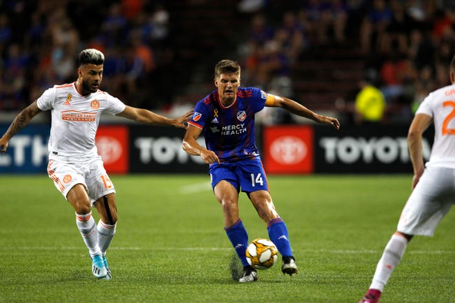 FC Cincinnati defender Nick Hagglund (14) drives past Atlanta United forward Hector Villalba (15) in the second half of the MLS soccer game between FC Cincinnati and Atlanta United FC at Nippert Stadium in Cincinnati, OH on Wednesday, Sept. 18, 2019.