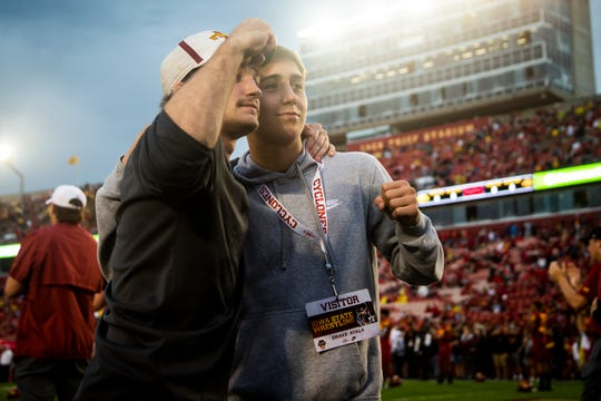 Fort Dodge junior Drake Ayala, right, and current Iowa State wrestler Aden Reeves pose for a photo on the field before the annual Cy-Hawk game at Jack Trice Stadium in September. Ayala is one of the most sought-after recruits in the country.