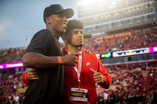 Anthony Echemendia poses for a photo with ISU wrestler David Carr on the field before the Cy-Hawk football game at Jack Trice Stadium on Saturday, Sept. 14, 2019 in Ames.