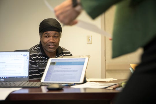 "John Pippen, 50 of Detroit meets with Project Clean Slate lead attorney Stephani LaBelle to discuss a possible expungement to his record with at the Samaritan Center in Detroit, Thursday, Sept. 12, 2019.  ""It's hard to find work with any kind of record,"" said Pippen."