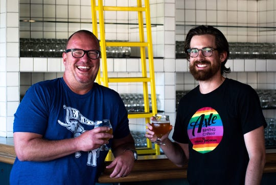 Axle Brewing Co. president Daniel Riley, left, and Eastern Market Brewing Co. managing partner Dayne Bartscht (wearing each other's shirts).