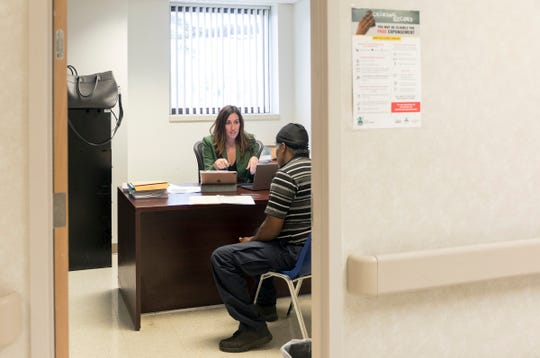 Project Clean Slate lead attorney Stephani LaBelle gives John Pippen, 50 of Detroit the news that his record is eligible for expungement at the Samaritan Center in Detroit, Thursday, Sept. 12, 2019.