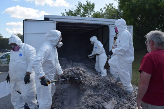 Dryer Vent Wizard staff prepare lint for the world-record-breaking ball of lint on Sept. 19, 2019.