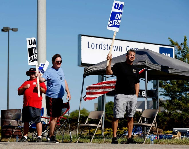 A picket line illustrated: Workers including Mike Yakim, 51 (blue shirt) who use to work at the Lordstown Assembly where the Chevy Cruze was made until the plant was closed March 8 of this year picket in front of the empty plant in Lordstown, Ohio on Wednesday, September 18, 2019. Yakim was one of several former workers who had been assigned to other plants that came to picket with other UAW members who are on strike against General Motors.