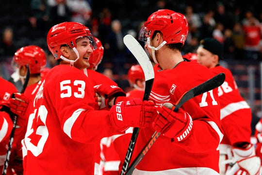 Red Wings left wing Taro Hirose and center Dylan Larkin celebrate after defeating the Bruins at Little Caesars Arena, March 31, 2019.