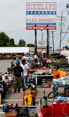 Customers shop at the Dixieland Flea Market in Waterford, Saturday, Aug. 3, 2019. The 80,000-square-foot flea market is the largest and oldest in the region. Over 80 vendors sell their items inside and 100 vendors are outside in the large parking lot.