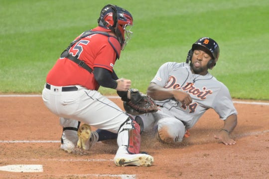 Indians catcher Roberto Perez (55) tags out Detroit Tigers left fielder Christin Stewart (14) in the fourth inning at Progressive Field on Sept. 18, 2019.