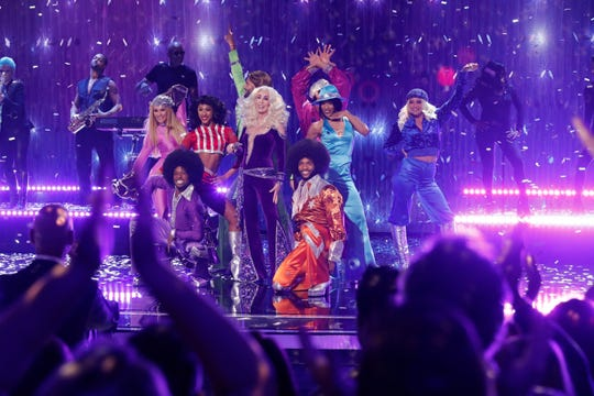 DuJuan Smart Jr. (bottom row, left), a dancer/choreographer who hails from Detroit, appeared with Cher on the 'America's Got Talent' final results show for season 14.