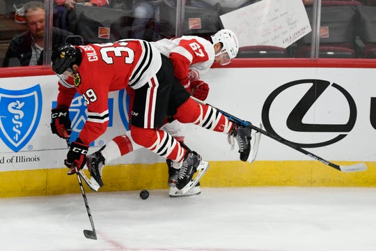 Red Wings' Taro Hirose collides with Blackhawks' Dennis Gilbert during the first period Wednesday.