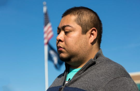Abraham Navarretete-Morales stands during a press conference outside the US Citizenship and Immigration Services in Detroit, Thursday, Sept. 19, 2019.  Morales requested a deferral on humanitarian grounds to stay in the U.S. following a kidney transplant last year and the need for medication here he needs to survive but delays on approval mean his private health insurance was cancelled.