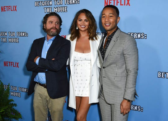 "Zach Galifianakis, from left, Chrissy Teigen and John Legend arrive at the Los Angeles premiere of ""Between Two Ferns: The Movie."""