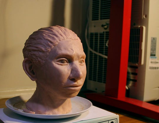 This image provided by Hebrew University in Jerusalem shows a statue reconstruction of a juvenile female Denisovan based on a skeletal profile reconstructed from ancient DNA methylation maps.