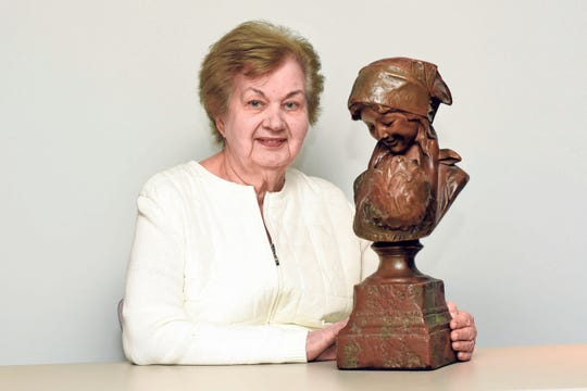 Elaine Fontana with her bust of a mother and child.