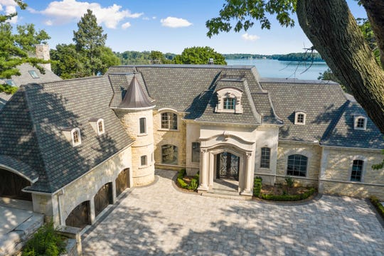 This 11,000 square-foot suburban palace in Orchard Lake is listed for $5 million. Designed by Lou Desrosiers and built in 2018, the 32-room house features a great room with floor to ceiling windows that overlook the lake.