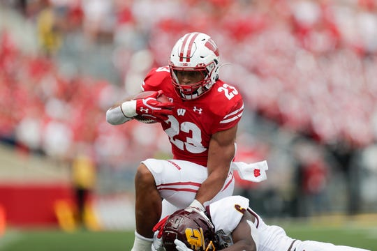 Wisconsin running back Jonathan Taylor leads the nation with eight total touchdowns this season.