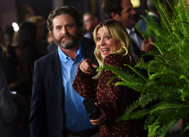 """Zach Galifianakis, left, and Kaley Cuoco arrive at the Los Angeles premiere of """"Between Two Ferns: The Movie"""" at ArcLight Hollywood on Monday, Sept. 16, 2019."""