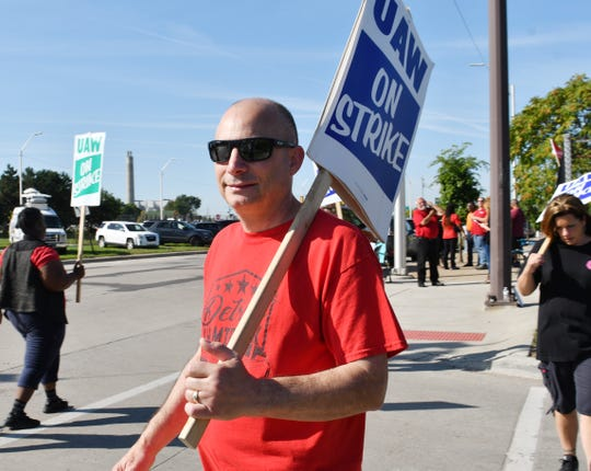 UAW member Mark Yaklin walks the picket line Thursday outside the GM Detroit-Hamtramck assembly plant.