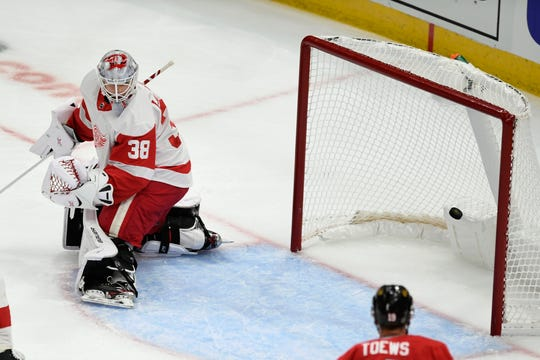 Detroit Red Wings goalie Filip Larsson (38) misses a goal made by Chicago Blackhawks' Duncan Keith during the second period of a preseason game on Wednesday.