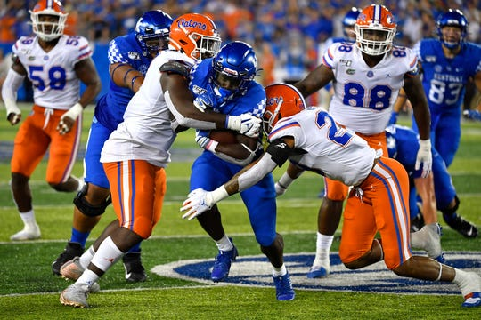Defensive lineman Zachary Carter, left, and defensive back Trey Dean III, right, are part of a Florida defense that leads the country in sacks with 16.
