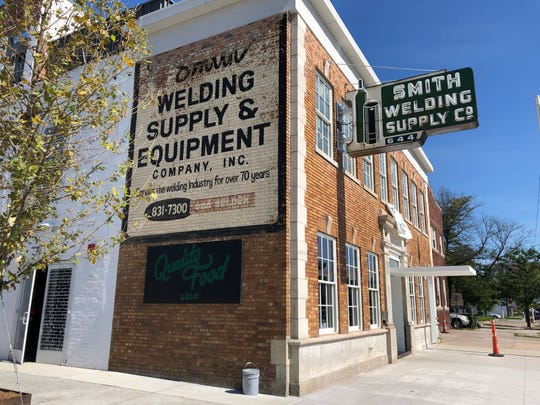 Smith & Co. restaurant is inside a century-old building on Selden that was Smith Welding Supply Co. until 2007.
