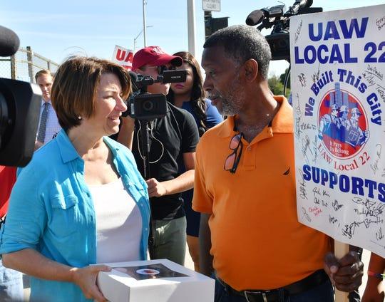 Democratic Minnesota U.S. Sen. Amy Klobuchar meets Wiley Turnage, 58, President of UAW Local 22 on the picket line Sept. 19, 2019, at the General Motors Detroit-Hamtramck plant.