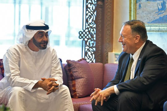 U.S. Secretary of State Mike Pompeo, right, meets with Abu Dhabi Crown Prince Mohamed bin Zayed al-Nahyan in Abu Dhabi, United Arab Emirates, Thursday, Sept. 19, 2019. Iran's foreign minister warned Thursday that any attack on his country will result in  war  pushing up tensions across the Persian Gulf.