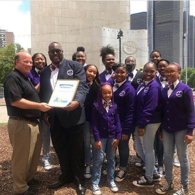 Mayor Mike Duggan left presents a certificate to Choir Director Anthony White of the Detroit Youth Choir earlier this year.