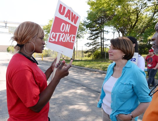 Senator Amy Klobuchar talks to striking UAW member Andrea Chenault, 34, of Detroit outside GM's Detroit-Hamtramck plant about her job security because Chenault is a temporary worker.
